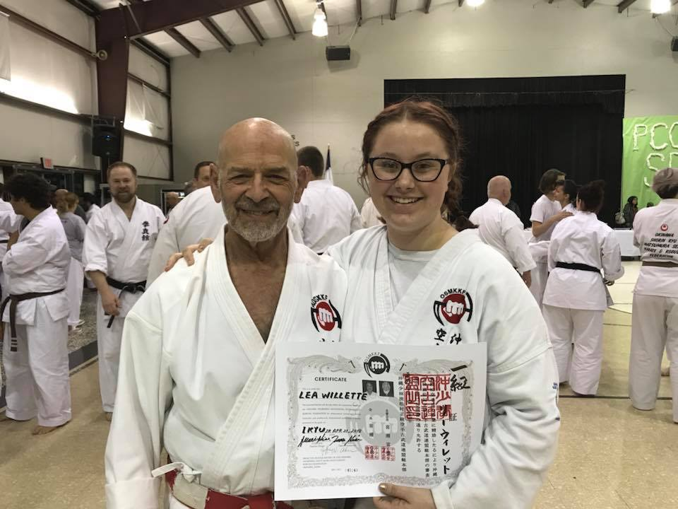 Lea Willette after receiving 1st Kyu promotion with Hanshi Ader