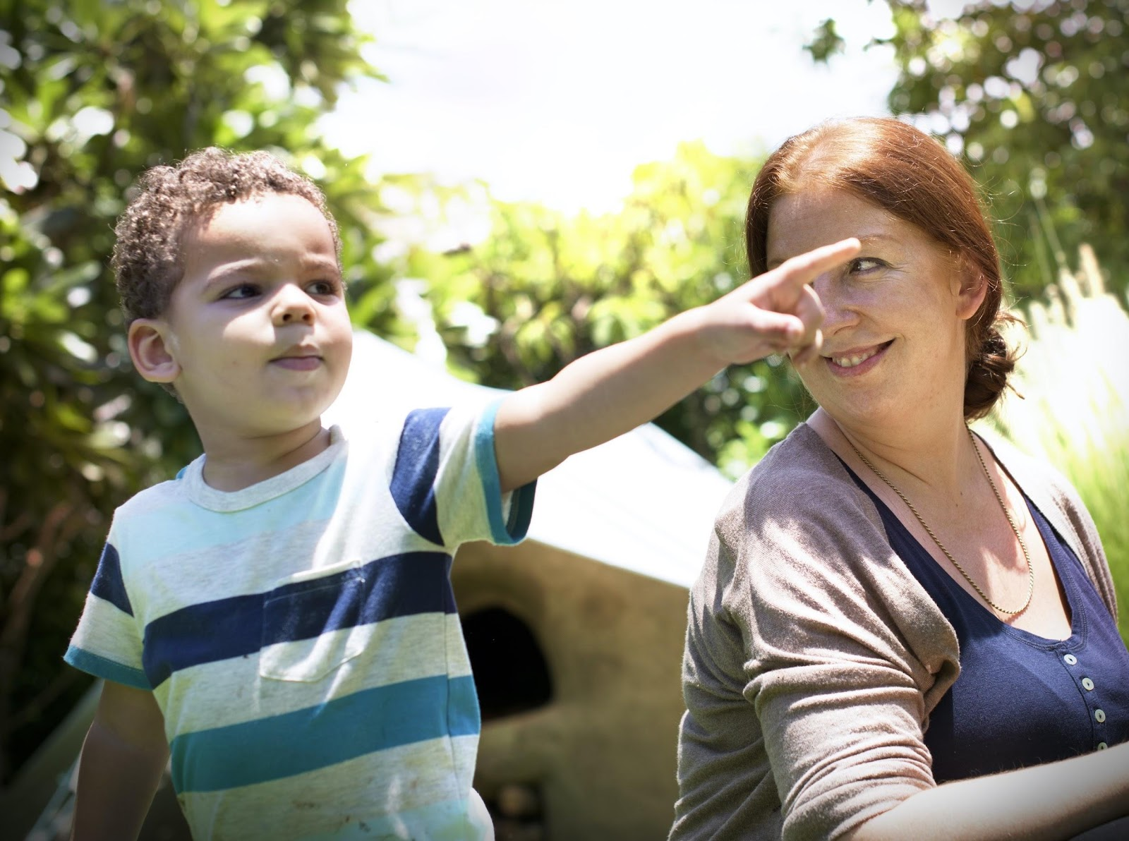 mother looking at child pointing
